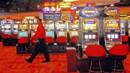 Workers at the permanent Meadows Casino move about the 3,200-plus video slot machines before opening the doors for a test outing for charity Monday.