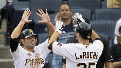 Pirates first baseman Adam LaRoche (25) is greeted by second baseman Freddy Sanchez, who scored on LaRoche's ninth-inning home run off Mets pitcher Francisco Rodriguez yesterday.
