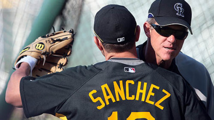 Pirates second baseman Freddy Sanchez, hugs Rockies manager and former Pirates manager Jim Tracy before last night's game.