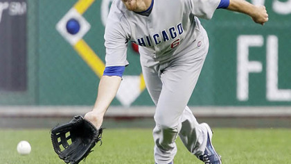 Cubs right fielder Micah Hoffpauir fields a fourth-inning single by Pirates second baseman Freddy Sanchez.