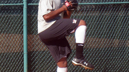 Donnie Veal, the Pirates' Rule 5 draft pick, winds up during a bullpen session Friday in Bradenton, Fla.