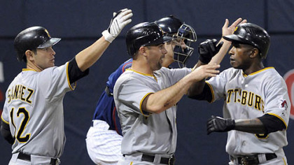 Pirates Freddy Sanchez, left, and Jack Wilson, center, congratulate Nyger Morgan, right, on his two-run home run off Minnesota's Glen Perkins in the third inning.