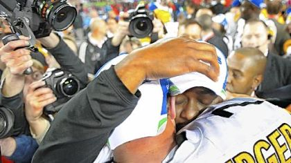 Coach Mike Tomlin sheds a tear while hugging quarterback Ben Roethlisberger.