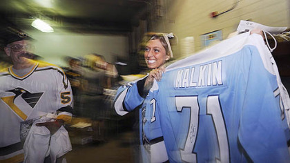 Taylor Dettore, a senior at Neshannock High School, shows off the autographed Evgeni Malkin jersey she received at last night's Penguins playoff game at Mellon Arena.