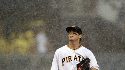 Pirates third baseman Andy LaRoche stands in the rain during yesterday's game.