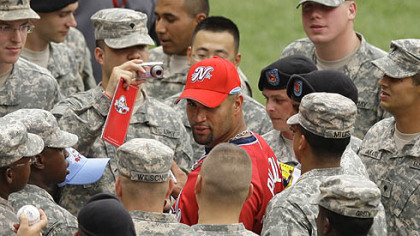 Cardinals Albert Pujols of the St. Louis Cardinals signs autographs for military personnel before the game.