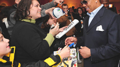 Hines Ward signs autographs before the debut of the NFL Films documentary on the Steelers' super season yesterday at the AMC Lowes Waterfront.
