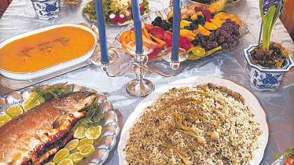 This Persian New Year feast, prepared by Shukuh Ghaznavi, an Iranian professor who lives in Indiana Township,includes salmon, mahi mahi, rice, and a number of other colorful dishes.