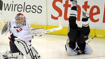 Chris Kunitz goes flying behind Capitals' goaltender Simeon Varlamov in overtime of game 6 of the second round of the Stanley Cup Playoffs at Mellon Arena Monday.
