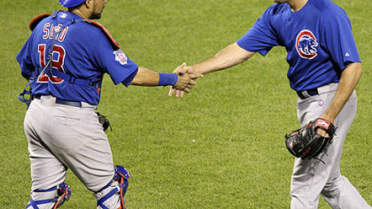Chicago Cubs closer Kevin Gregg, right, and catcher Geovany Soto congratulate each other after the final out of the Cubs' 3-1 win last night.