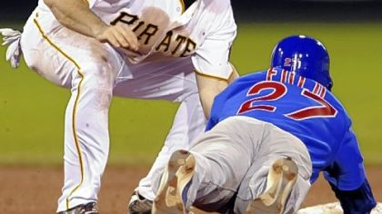 Pirates shortstop Jack Wilson tags out Cubs outfielder Sam Fuld at second base on a steal attempt in the eighth inning last night.