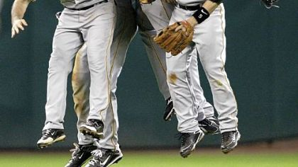 Pirates shortstop Jack Wilson (2), second baseman Ramon Vazquez (5) and outfielders Brandon Moss, right, Andrew McCutchen (22) and Garrett Jones celebrate after beating the Astros, 6-3, last night.