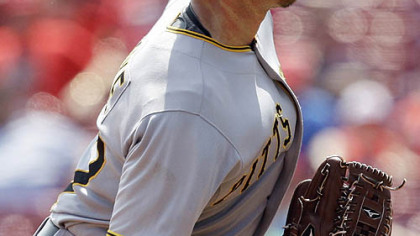 Pirates pitcher Zach Duke throws against the Reds during the sixth inning.