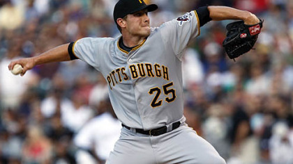 Pirates starting pitcher Kevin Hart works against the Rockies in the first inning.
