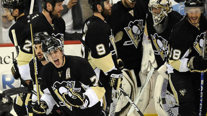Evgeni Malkin celebrates as he leaves the ice after teammate Kris Letang shot the winning goal in overtime against the Capitals in Game 3 of the second round of the Stanley Cup Playoffs last night.