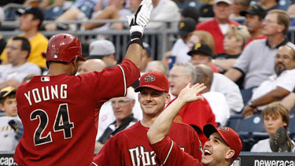 Diamondbacks outfielder Chris Young is greeted by manger A.J. Hinch, center, and teammates after hitting a two-run home run off Pirates pitcher Zach Duke in the fourth inning.