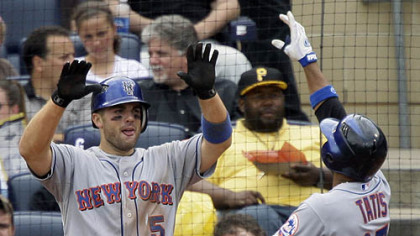 Mets first baseman Fernando Tatis, right, crosses home plate to greetings from third baseman David Wright (5), who scored on Tatis' two-run home run in the sixth inning off Pirates pitcher Jeff Karstens yesterday.