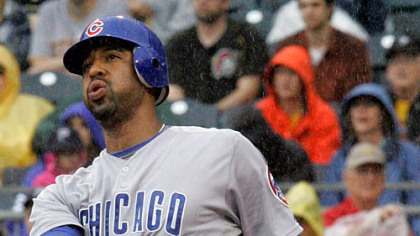 Cubs first baseman Derrek Lee follows through on a two-run homerun off Pirates pitcher Daniel McCutchen during the third inning.