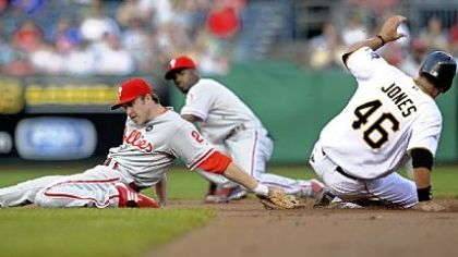 Garrett Jones slides into second with a steal as Phillies' Chase Utley stretches to make the tag in the first inning.