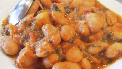 A platter of gigantes plaki, a Greek bean dish served in tavernas all over the country. This version is from Sterna of Bloumosifis in Vamos, a small town on the island of Crete.