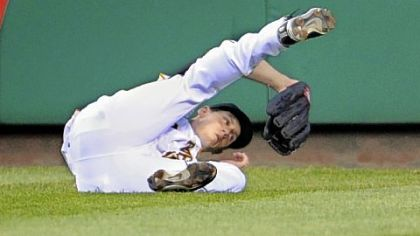Pirates outfielder Jeff Salazar makes a diving grab on a ball hit by Diamondbacks outfielder Gerardo Parra in the fifth inning.