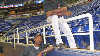 Pirates outfielders Nyjer Morgan, below, and Andrew McCutchen at the Metrodome in Minneapolis.