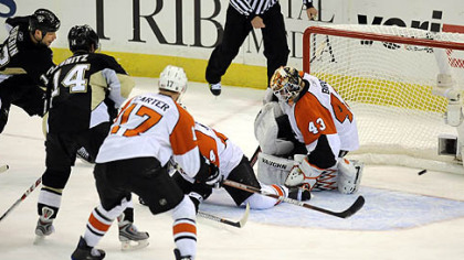 Bill Guerin scores the winning goal against the Flyers in overtime.