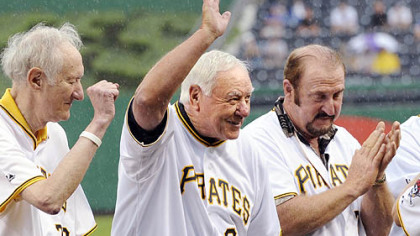 Pirates hall-of-famer Bill Mazeroski waves to the crowd after being introduced during a ceremony honoring the 100th anniversary of Forbes Field last night. Mazeroski is flanked by Nellie King, left, and Bob Robertson.