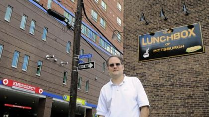 Brian Peltz, owner of the Lunchbox of Pittsburgh, a sandwich shop which also sells convenience items such as cigarettes, is 16 feet from the emergency room entrance of the new Children&#039;&#039;s Hospital in Lawrenceville.