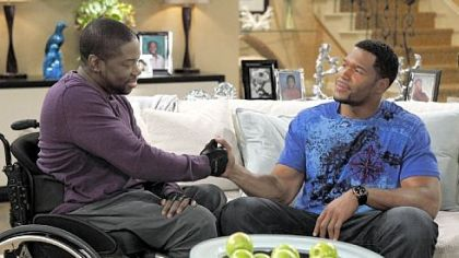 "Daryl ""Chill"" Mitchell, left, and Michael Strahan work things out in the new Fox comedy ""Brothers."""