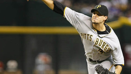 Pirates pitcher Charlie Morton throws against the Diamondbacks in the first inning last night in Phoenix.