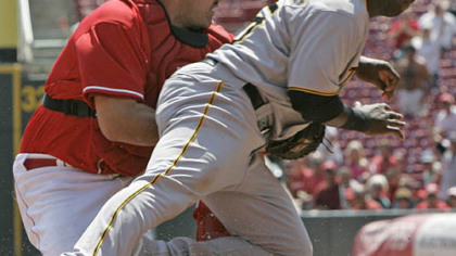 Reds catcher Corky Miller tags out Pirates outfielder Lastings Milledge at home in the fourth inning during yesterday's game in Cincinnati.
