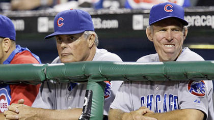 Cubs manager Lou Piniella, left, and bench coach Alan Trammell watch the final out in the ninth inning of Chicago's 3-0 loss.