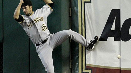 Pirates right fielder Garrett Jones falls after leaping at the wall as he tries to catch a two-run triple hit by Astros third baseman Geoff Blum during the first inning last night.