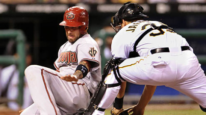 Diamondbacks infielder Ryan Roberts slides into home plate safely as Pirates catcher Jason Jaramillo can&#039;t hold on to the ball in the eighth inning Wednesday.