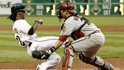 Pirates outfielder Andrew McCutchen scores from first base on a double by Lastings Milledge as Diamondbacks catcher Miguel Montero waits for the throw in the third inning.