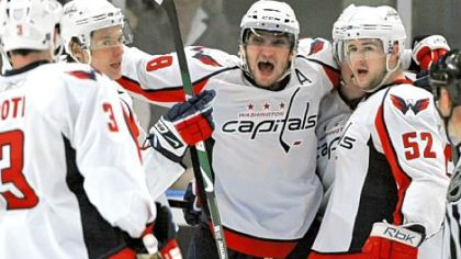 The Capitals' Alex Ovechkin, center, celebrates with teammates after scoring in the second period against the Rangers yesterday at Madison Square Garden in New York. The Capitals went on to win and force a Game 7 in Washington in the first-round NHL playoffs series.