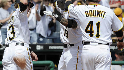 Pirates' Craig Monroe is greeted at home by Nate McLouth and Ryan Doumit after hitting a three run homer in the sixth against the Braves at PNC Park.