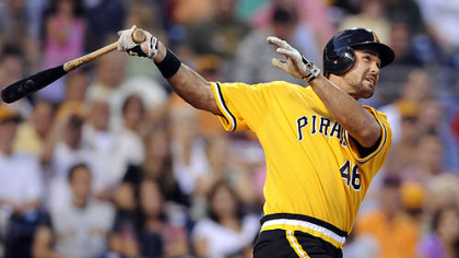 Pirates' Garrett Jones hits a three-run home run against the Reds in the third inning tonight at PNC Park.