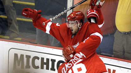 Detroit's Darren Helm, top, celebrates scoring the game-winning goal against the Chicago Blackhawks in overtime of Game 5 of the NHL hockey Western Conference finals last night in Detroit.