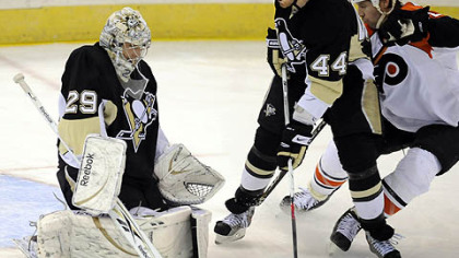 Brooks Orpik helps defend the goal Marc-Andre Fleury makes a save on Flyers Mike Knuble in the second period.