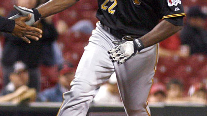 Pirates outfielder Andrew McCutchen rounds the bases after hitting a solo home run off Reds pitcher Johnny Cueto in the sixth inning during the second game of a doubleheader yesterday in Cincinnati. The Reds won 6-3.