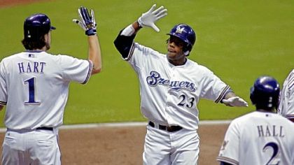 The Brewers' Rickie Weeks is congratulated by Corey Hart after hitting a three-run home run against Jeff Karstens last night.