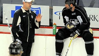Penguins head coach Dan Bylsma (left) talks with forward Bill Guerin during practice at the Mellon Arena for their Stanley Cup Finals Game 1 with the Detroit Red Wings tomorrow.