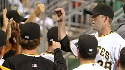Paul Maholm,  is greeted by teammates in the dugout. Maholm was the winning pitcher in the Pirates' 3-1 victory.