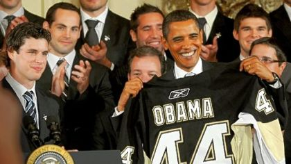 Penguins captain Sidney Crosby presents President Barack Obama with a jersey yesterday.