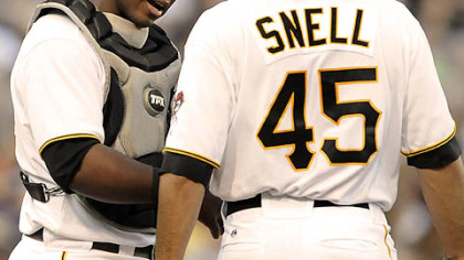 Pirates catcher Robinzon Diaz talks with starter Ian Snell during last night's 5-4 loss to the Indians at PNC Park.