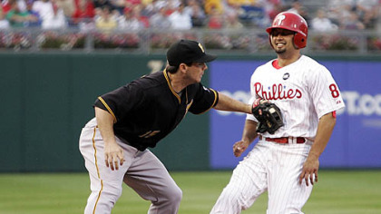 Pirates third baseman Andy LaRoche tags out Phillies outfielder Shane Victorino trying to steal third base in the first inning of last night&#039;s game.