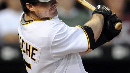Pirates third baseman Andy LaRoche hits a single in the fourth inning.