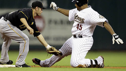 Houston Astros' Carlos Lee (45) is tagged out at second base by Freddy Sanchez, left, while trying to stretch a single into a double during the fifth inning of yesterday's game in Houston.